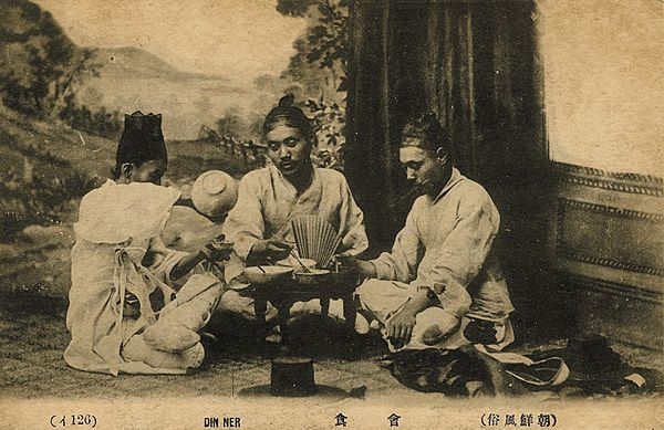 Picture depicting a Korean dinner table. Note that the picture is taken on a stage; Many of these photos were sold to Japan and other countries as exotic collections.