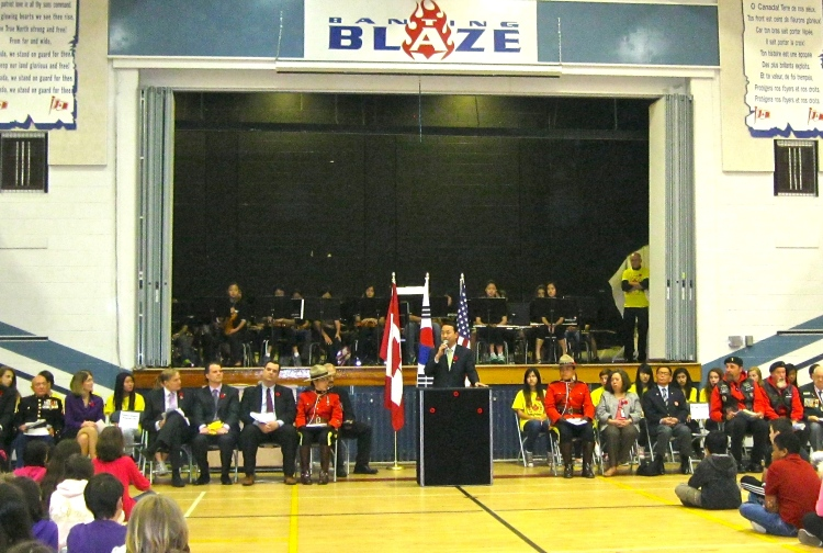 Consul General Yeon-Ho Choi of the Republic of Korea addresses students and members of the public at Banting Middle School in Coquitlam to commemorate the 60th Anniversary of the Korean War Armistice.