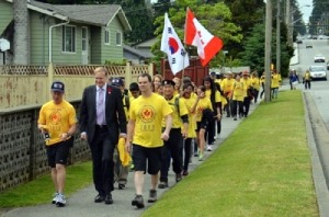 Guy Black, MPs Peter Julian and Fin Donnelly set out with supporters on 72km walk.