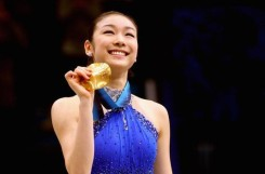 VANCOUVER, BC - FEBRUARY 25: Kim Yu-Na of South Korea celebrates winning the gold medal in the Ladies Free Skating during the medal ceremony on day 14 of the 2010 Vancouver Winter Olympics at Pacific Coliseum on February 25, 2010 in Vancouver, Canada. (Photo by Cameron Spencer/Getty Images)