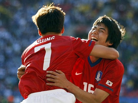South Korea's Park Ji-sung celebrates his goal with teammate Ki Sung-yong during their 2010 World Cup Group B soccer match against Greece at Nelson Mandela Bay stadium in Port Elizabeth