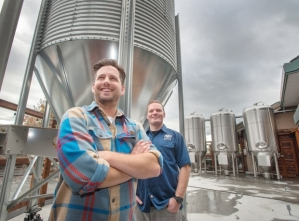 Ian Rodgers (left) and Kevin Winter (head brewer) standing proudly inside the Mission Springs Brewery.