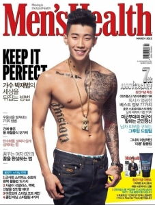 2PM singer Park Jae-Bum shows off his tattoos on the cover of Men's Health.