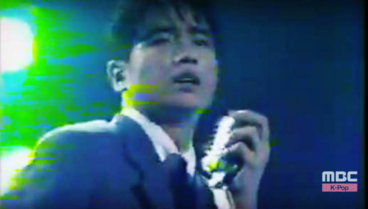 Korean singer Kim Bum Soo in a screen grab from a 1995 video for Happy End.