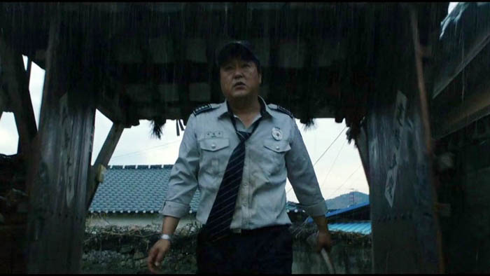 Kwak Do-won plays a rural policeman in the Korean horror film The Wailing.