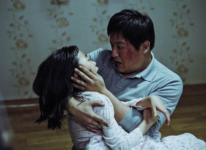 Kim Hwan-hee (left) as Hyojin, and Kwak Do-won as her father, policeman Jeon Jong-gu, in the Korean horror film The Wailing. The film is being shown in Montreal at the Fantasia International Film Festival.